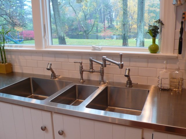 Stainless steel kitchen countertop with 3 sinks welded in